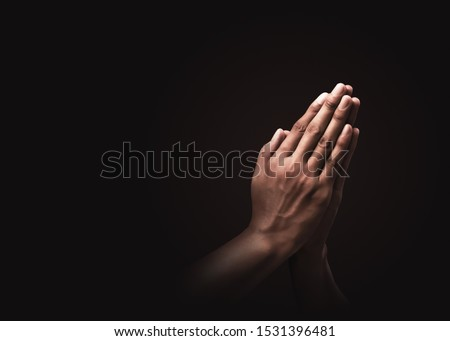 Praying hands with faith in religion and belief in God on dark background. Power of hope or love and devotion. Namaste or Namaskar hands gesture. Prayer position. #1531396481