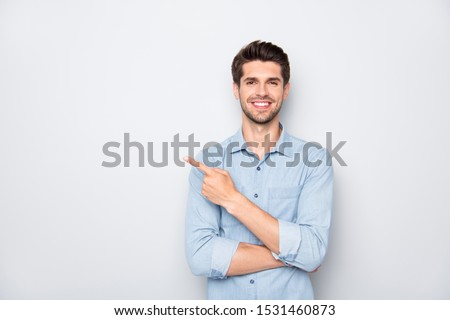 Portrait of positive cheerful guy promoter point index finger recommend ads select suggest adverts  wear casual style clothes isolated over grey color background #1531460873