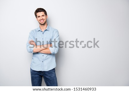 Portrait of positive cheerful cool college university man cross hand feel like true leader person wear denim jeans style outfit isolated over grey color background #1531460933