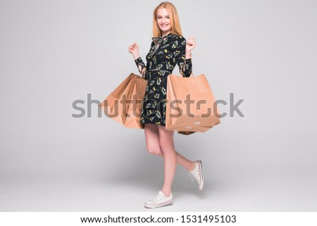 Young pretty woman with shopping packages isolated on white #1531495103