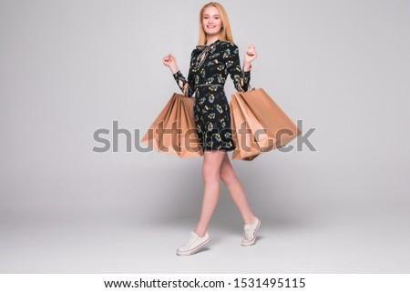 Portrait of young happy smiling woman with shopping bags, isolated over white background #1531495115