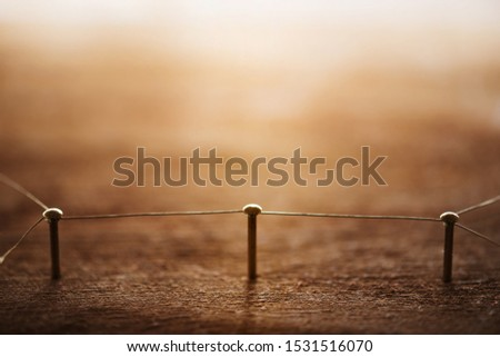 Connecting people. The middle man. A single entity which connects tow party's or groups. Networking, social media, internet communication abstract concept image. Web of gold wires on rustic wood. #1531516070