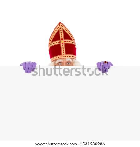 Sinterklaas or saint Nicholas holding blank cardboard. isolated on white background. Dutch character of Santa Claus #1531530986