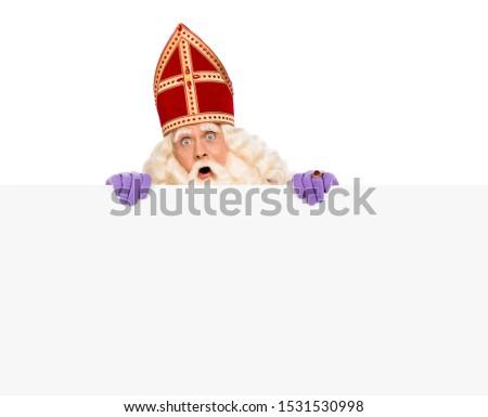 Sinterklaas or saint Nicholas holding blank cardboard. isolated on white background. Dutch character of Santa Claus #1531530998
