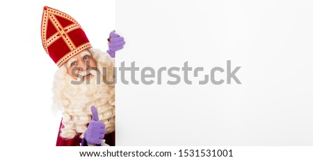 Sinterklaas or saint Nicholas holding blank cardboard. isolated on white background. Dutch character of Santa Claus #1531531001