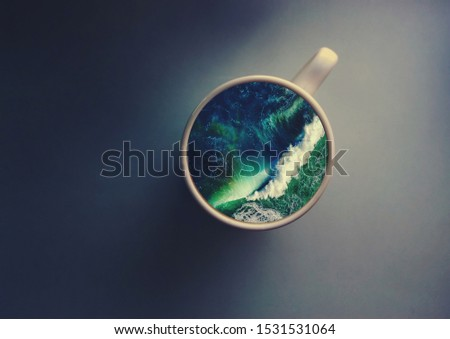 White cup with water. Sea. Ocean. Sea waves. Creative postcard. #1531531064