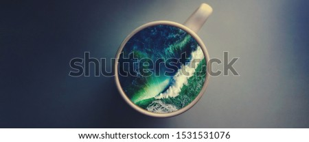 White cup with water. Sea. Ocean. Sea waves. Creative postcard. #1531531076
