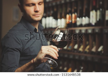 Bokal of red wine on background, male sommelier appreciating drink #1531648538