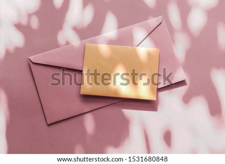 Holiday marketing, business kit and email newsletter concept - Beauty brand identity as flatlay mockup design, business card and letter for online luxury branding on pastel shadow background
