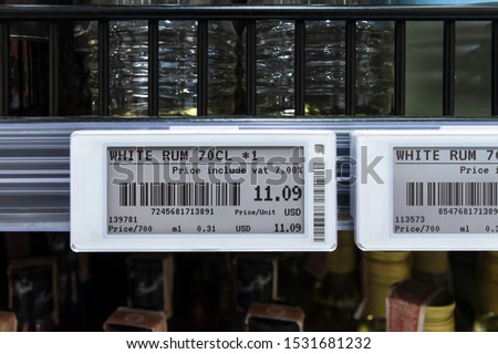 Smart retail digital store technology concept.Electronic Shelf Label(ESL) led for automatically updated displaying product pricing on shelves for retail business. Price is change from control service. Royalty-Free Stock Photo #1531681232
