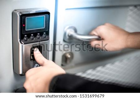 Scanning fingerprint to open security door in private building. Unlock concept #1531699679