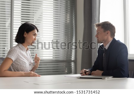 Recruiter listening to young Asian candidate at job interview, confident applicant answering to recruiter questions, introduction, good first impression, recruitment process, human resources #1531731452