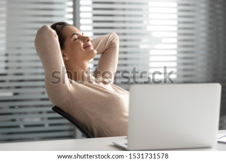 Satisfied businesswoman with hands behind head relaxing in comfortable office chair during break, smiling female employee with closed eyes resting after work done, leaning back, daydreaming #1531731578