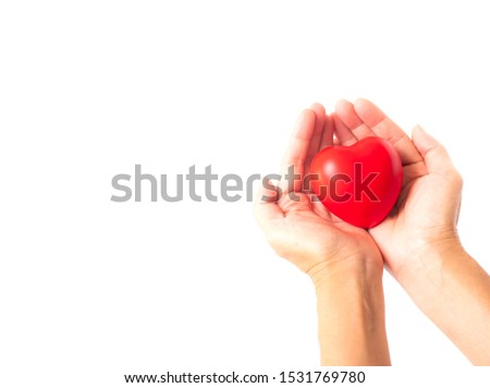 holding red plastic in hands on white background #1531769780