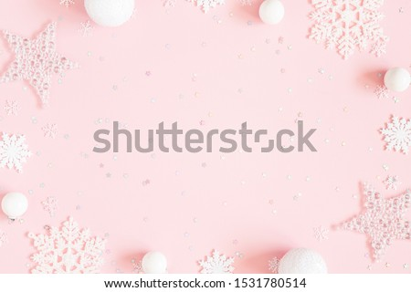 Christmas composition. White decorations on pastel pink background. Christmas, winter, new year concept. Flat lay, top view, copy space