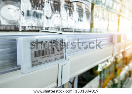 Smart retail digital store technology concept.Electronic Shelf Label(ESL) led for automatically updated displaying product pricing on shelves for retail business. Price is change from control service. #1531804019