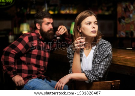 Female male alcoholism. Woman and man alcoholism. Woman alcoholic beverage in bar. Young woman has problems with alcohol. Alcoholism, alcohol addiction, male alcoholic. Young man drinking alcohol. #1531828487