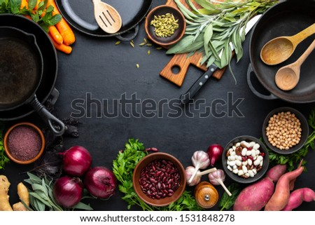 Culinary background with kitchen utensils and various culinary ingredients, healthy vegetarian protein sources, vegetables and spices for cooking healthy food Royalty-Free Stock Photo #1531848278