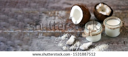 Keto diet. Keto drinks. Jars of coconut milk, coconut flakes, coconut. Coconut milk extraction. Vegan milk. Selective focus. Macro. #1531887512