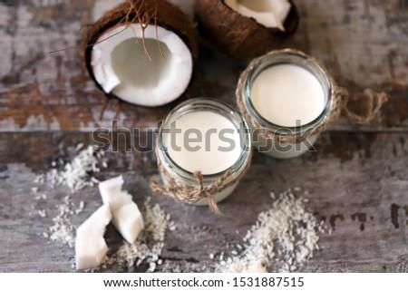 Keto diet. Keto drinks. Jars of coconut milk, coconut flakes, coconut. Coconut milk extraction. Vegan milk. Selective focus. Macro. #1531887515