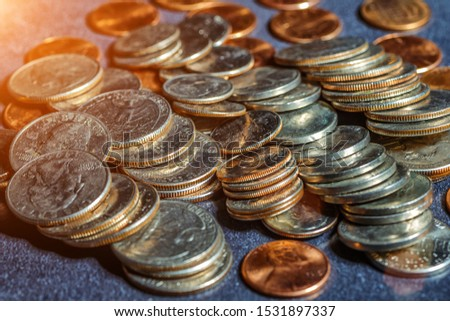 Pile of Golden coin, silver coin, copper coin, quarters, nickels, dimes, pennies, fifty cent piece and dollar coins. Various USA coins, American coins for business, money, financial coins and economy #1531897337
