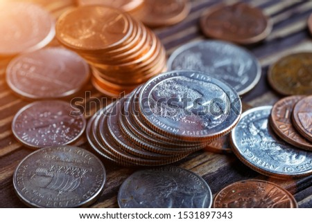 Pile of Golden coin, silver coin, copper coin, quarters, nickels, dimes, pennies, fifty cent piece and dollar coins. Various USA coins, American coins for business, money, financial coins and economy #1531897343