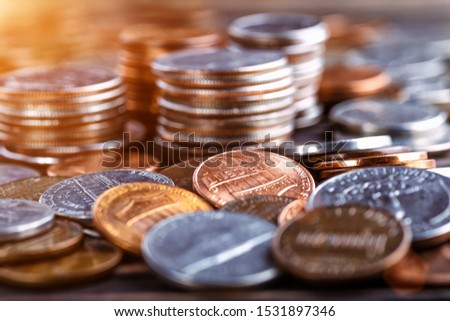Pile of Golden coin, silver coin, copper coin, quarters, nickels, dimes, pennies, fifty cent piece and dollar coins. Various USA coins, American coins for business, money, financial coins and economy #1531897346