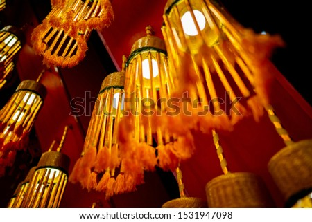 Blurred old incense in festival of buddhist, colorful object on dark night background #1531947098