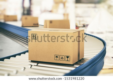 Cardboard boxes on conveyor rollers ready to be shipped by courier for distribution #1531981220
