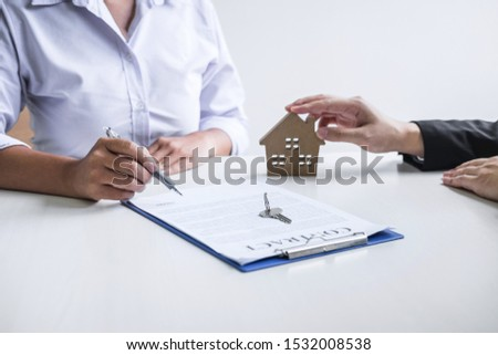 Estate agent broker reach contract form to client signing agreement contract real estate with approved mortgage application form, buying or concerning mortgage loan offer for and house insurance. #1532008538