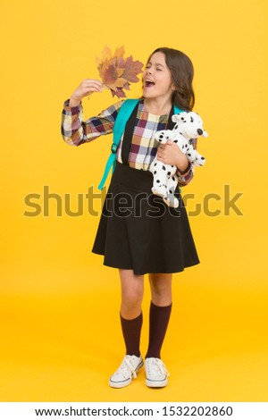 Beauty of fall. Little schoolchild hold fall leaves and toy. Small girl enjoy fall foliage. Celebrate autumn holidays. School time. Fall season. Back to school. Play and learn. #1532202860