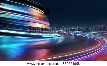 Abstract motion curvy urban road with neon light motion effect applied . Automobile background use concept . Royalty-Free Stock Photo #1532224658