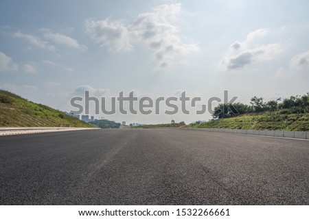 Outdoor asphalt road low angle perspective view background Royalty-Free Stock Photo #1532266661