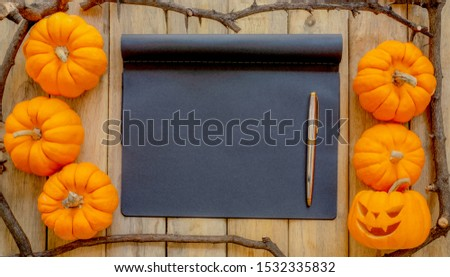 pumpkin background Halloween, scary pumpkin head or jack lantern cartoon on black notebook texture decorated with silver color pen, Halloween festival and thanksgiving concept with copy space card