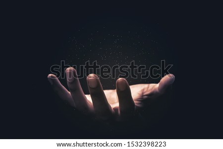 Praying hands with faith in religion and belief in God on blessing background. Power of hope or love and devotion. Magic powder floating on the magician hand. Royalty-Free Stock Photo #1532398223