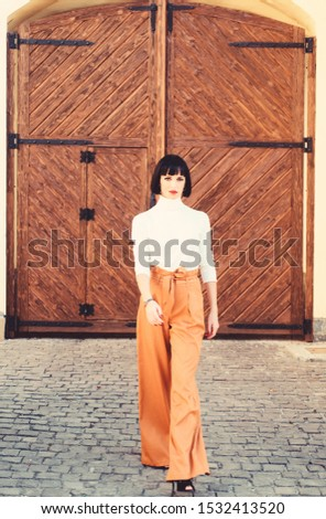 Girl makeup face wear loose high waisted pants. High waisted pants fashion trend. High waisted trousers. Woman attractive brunette wear fashionable clothes. Femininity and emphasize feminine figure. #1532413520