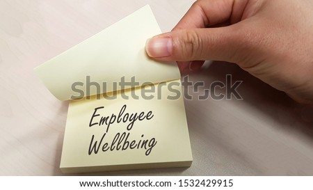 Employee Wellbeing concept using sticky pad Royalty-Free Stock Photo #1532429915