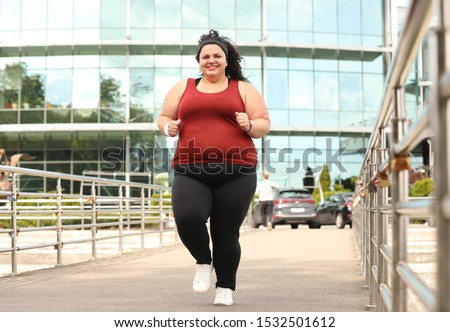 Beautiful overweight woman running outdoors. Fitness lifestyle #1532501612