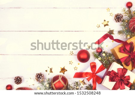 Christmas presents, branch of fire tree and decoration toys laid on white background of painted wooden planks with copy space for text. Holiday and New Year concept. #1532508248