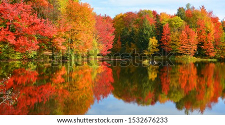 Fall landscape reflection Quebec province Canada