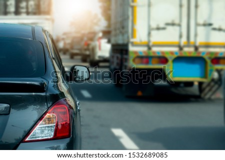 Luxury of gray car on the asphalt road. Traveling in the provinces during the bright period. With many cars. #1532689085