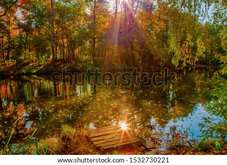beautiful autumn landscape with falling leaves in the lake #1532730221