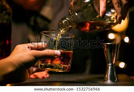 Bartender Serve Whiskey, on wood bar, #1532756966