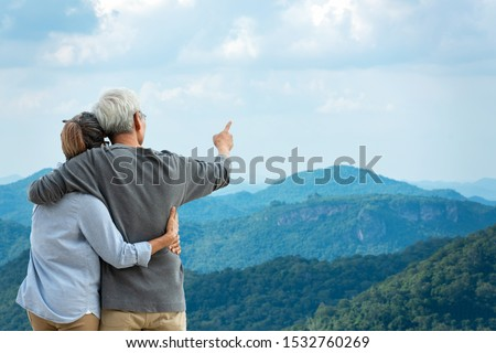 Asian Lifestyle senior couple hug and pointing the mountain nature.  Old people happy in love romantic and relax time. Tourism family elderly retirement travel in summer leisure and destination. #1532760269