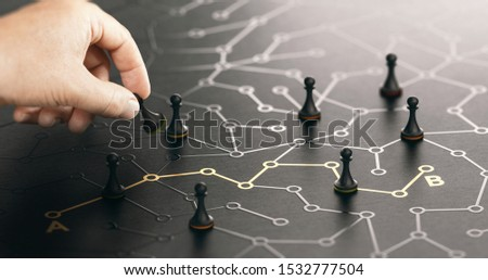 Hand moving pawn on a conceptual labyrinth. Shortcut from point A to B or career guidance concept. Composite image between a hand photography and a 3D background. Royalty-Free Stock Photo #1532777504