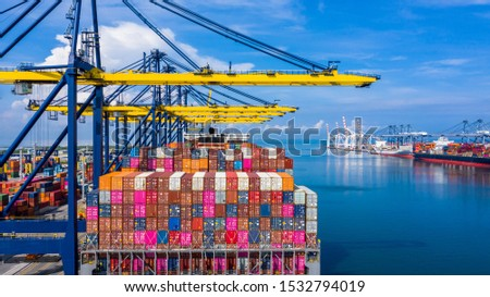 Container cargo ship at industrial port with industrial crane in import export business logistic and transportation of international by container cargo ship in the open sea, Aerial view cargo freight. #1532794019