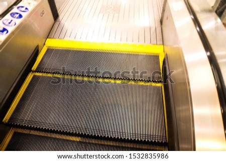 Modern escalator  in  modern shopping mall interior. #1532835986