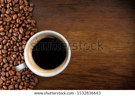 coffee cup and beans placed on a wooden board With copy space for text. #1532836643