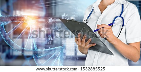 Abstract luminous DNA molecule. Doctor using tablet and check with analysis chromosome DNA genetic of human on virtual interface. Medicine. Medical science and biotechnology.          - Image #1532885525