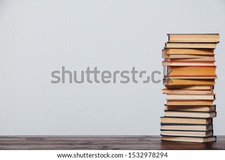 stacks of educational books university library background #1532978294